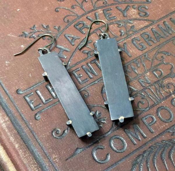 back of key and snake earrings