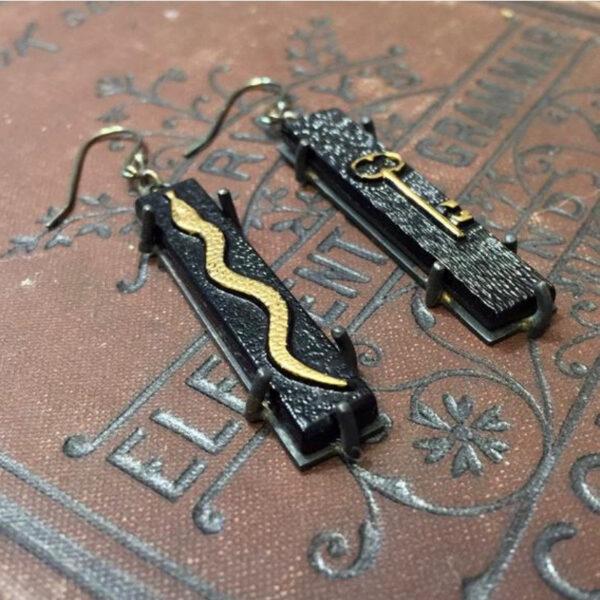 sterling skeleton key and snake earrings