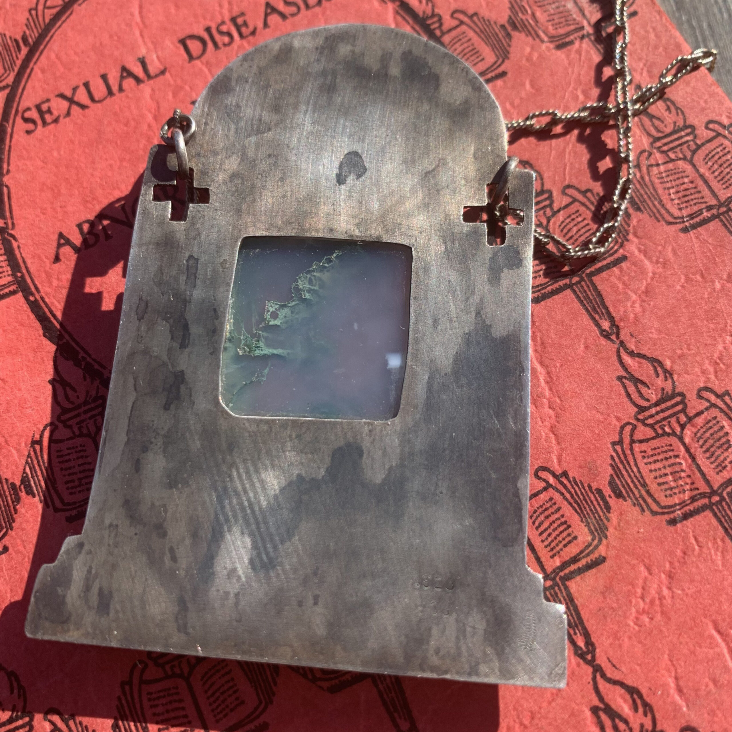 Back of tombstone and moss necklace